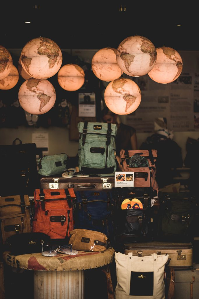 froom full of globe lights and luggage