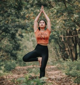 best workouts if you hate to exercise woman in yoga pose in woods