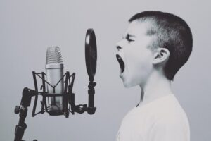 how to start a child in acting kid yelling into microphone