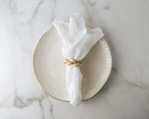 white napkin on white plate how and why to switch from paper napkins to cloth